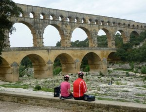 Two of our cycling group ponder the Roman aqueduct at Pont du Gard.
