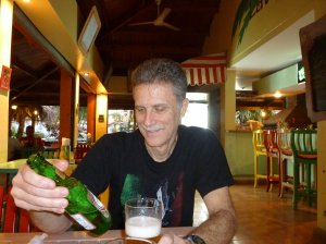 Paul's not above trying the local beer, however.