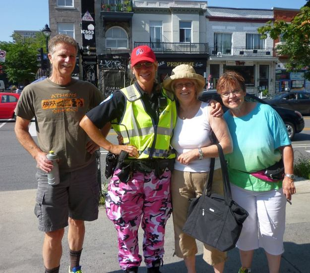 """Montreal chic"" - a member of Montreal's finest sports pink camouflage pants, a creative protest against changes to their pension plan."
