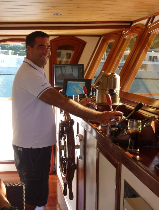 Captain Josip at the helm of the Harmonia.